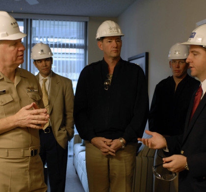 080111-N-8273J-033 SAN DIEGO (Jan. 11, 2008) Chief of Naval Operations (CNO) Adm. Gary Roughead talks with project managers while touring Pacific Beacon, the NavyÕs first large-scale housing privatization facility for single Sailors. The facility, constructed of four 18-story towers is scheduled for completion in 2009. U.S. Navy photo by Mass Communication Special